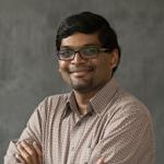 Headshot of Karthik Lakshmanan.