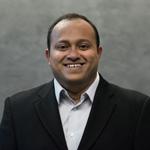 Headshot of Rajiv Menon.