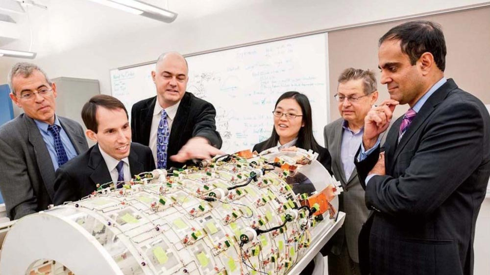 Researchers with a prototype of the boreliner, a massively parallel 124-channel imaging array.